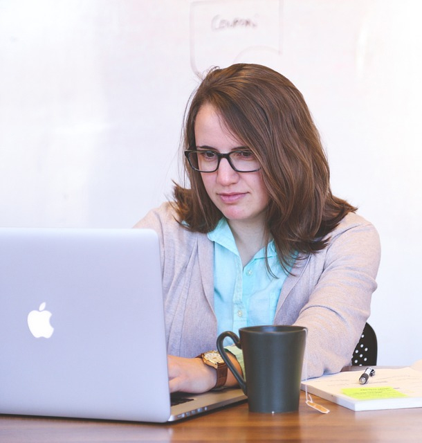 Professional Women is working using a Laptop for a Digital Agency